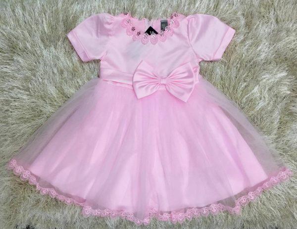 Đầm bé gái đính nơ màu hồng nổi bật