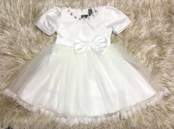 Đầm bé gái đính nơ màu trắng nổi bật