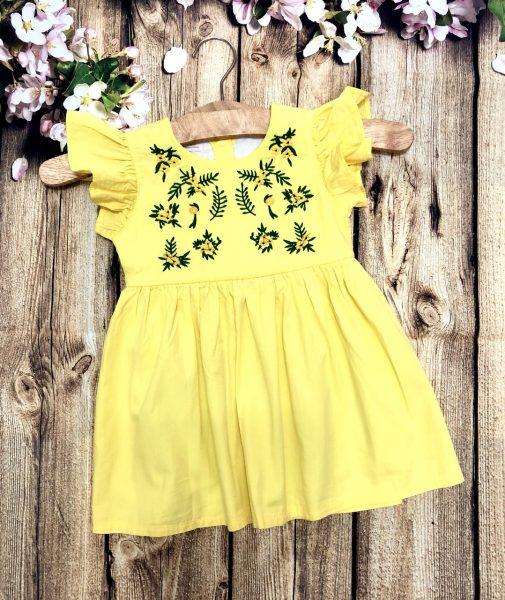 đầm bé gái màu vàng hoạ tiết bông phía trước
